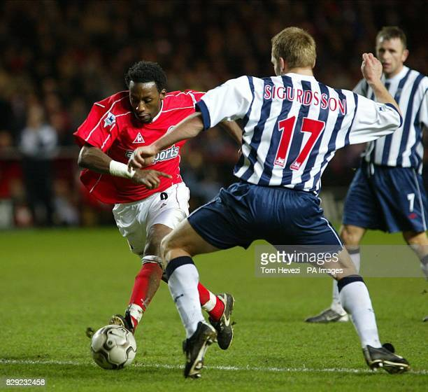 Charlton Athletic's Jason Euell and West Bromwich Albion's Larus Sigurdsson during their FA Barclaycard Premiership match at Charlton's The Valley...