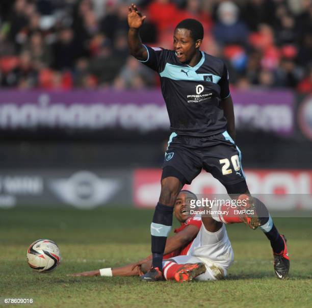 Charlton Athletic's Jonathan Obika tackles Burnley's Marvin Bartley