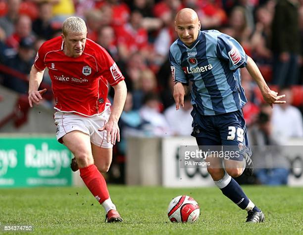 Charlton Athletic's Jonjo Shelvey gets away from Barnsley's Bobby Hassell
