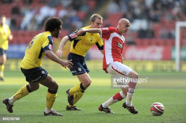 Charlton Athletic's Jonjo Shelvey gets away from Preston North End's Ross Wallace and Youl Mawene during the CocaCola Championship match at The...