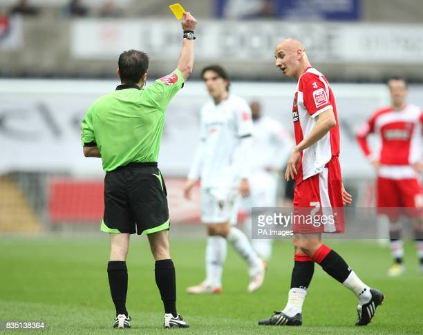 Charlton Athletic's Jonjo Shelvey is shown a yellow card by referee Keith Stround after fouling Swansea City's Leon Britton