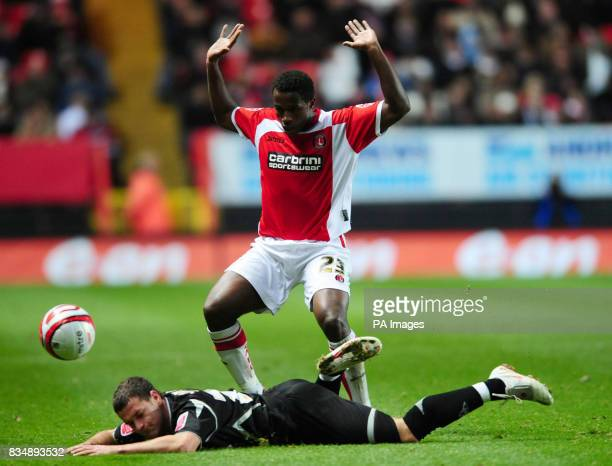 Charlton Athletic's Jose Semedo and Sheffield United's Billy Sharp battle during the CocaCola Football Championship match at The Valley London