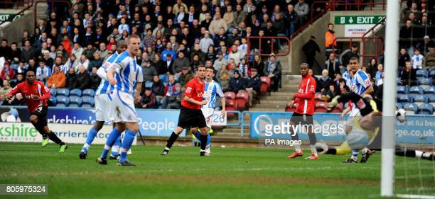 Charlton Athletic's Kyel Reid scores the equalising goal past Huddersfield Town's Alex Smithies during the CocaCola League One match at the Galpharm...