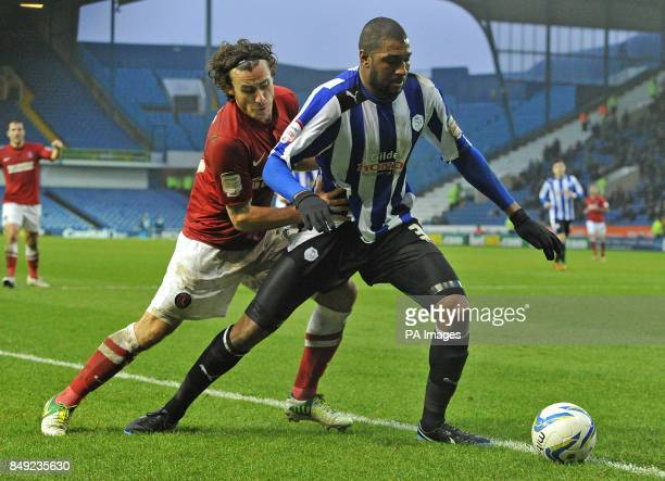 Charlton Athletic's Lawrie Wilson and Sheffield Wednesday's Reda Johnson battle for the ball during the npower Football League Championship match at...