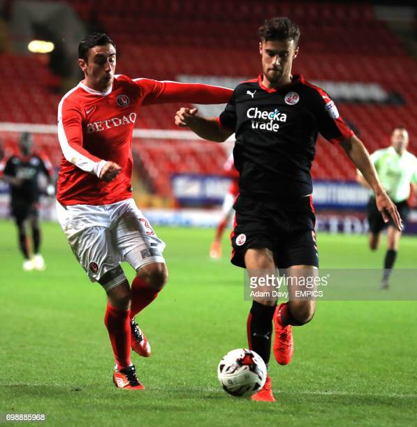Charlton Athletic's Lee Novak and Crawley Town's Alex Davey battle for the ball