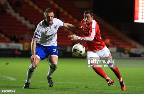 Charlton Athletic's Lee Novak battle for the ball with Oldham Athletic's Peter Clarke