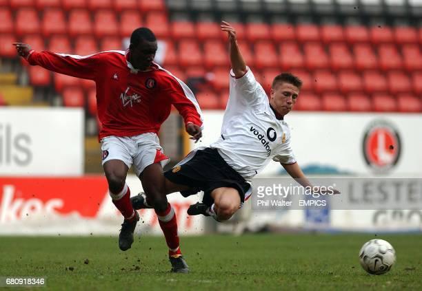 Charlton Athletic's Lloyd Sam send Manchester United's Phil Bardsley flying