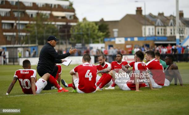 Charlton Athletic's manager Russell Slade talks to the players at half time