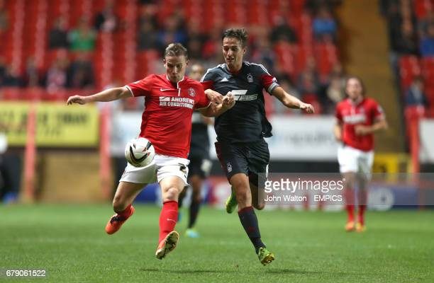 Charlton Athletic's Mark Gower and Nottingham Forest's Chris Cohen battles for possession of the ball