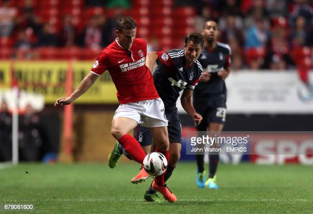 Charlton Athletic's Mark Gower and Nottingham Forest's Chris Cohen battle for the ball
