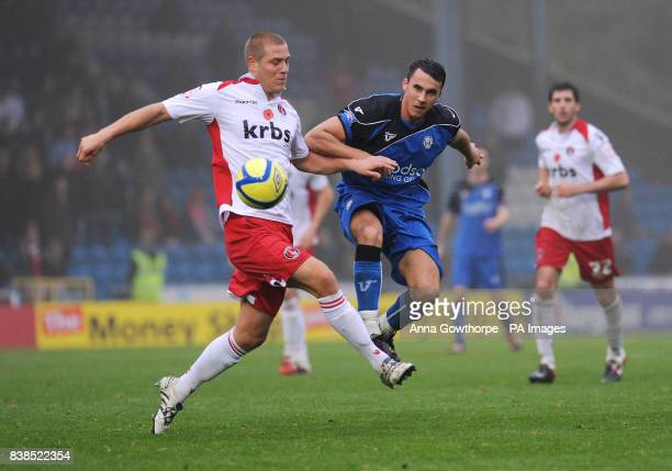 Charlton Athletic's Michael Morrison and FC Halifax's Lee Gregory battle for the ball during the FA Cup First Round match at The Shay Stadium Halifax
