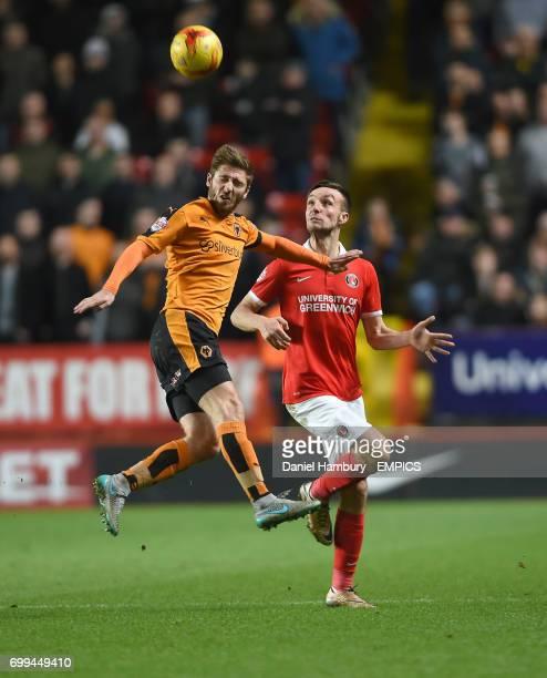 Charlton Athletic's Morgan Fox and Wolverhampton Wanderers' James Henry battle