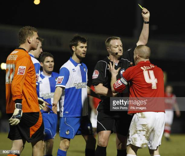 Charlton Athletic's Nicky Bailey is shown a yellow card for simulation by referee Trevor Kettle during a CocaCola League One match at the Memorial...