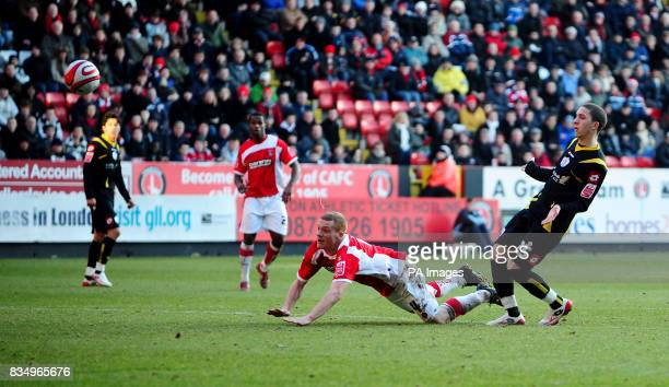 Charlton Athletic's Nicky Bailey scoring his second goal with a diving header during the CocaCola Championship match at The Valley London