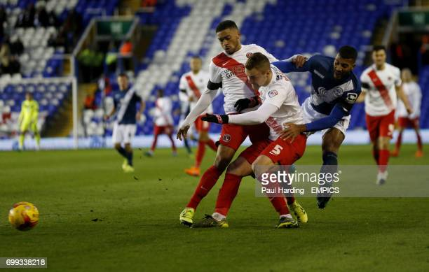 Charlton Athletic's Patrick Bauer and Birmingham City's Shane Lowry battle for the ball