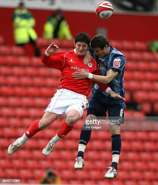 Charlton Athletic's Patrick McCarthy and Barnsley 's Jonathan Macken battle for the ball