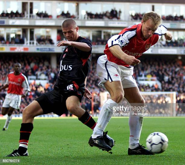 Charlton Athletic's Paul Konchesky and Arsenal's Dennis Bergkamp in action during the FA Barclaycard Premiership match between Arsenal v Charlton...