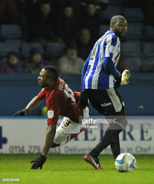 Charlton Athletic's Ricardo Fuller is taken down by Sheffield Wednesday's Reda Johnson during the npower Football League Championship match at...