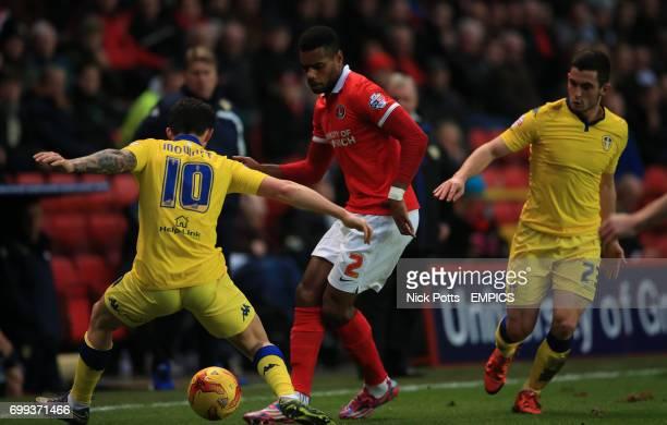 Charlton Athletic's Ricardo Vaz Te trys to beat Leeds United's Alex Mowatt and Leeds United's Mirco Antenucci