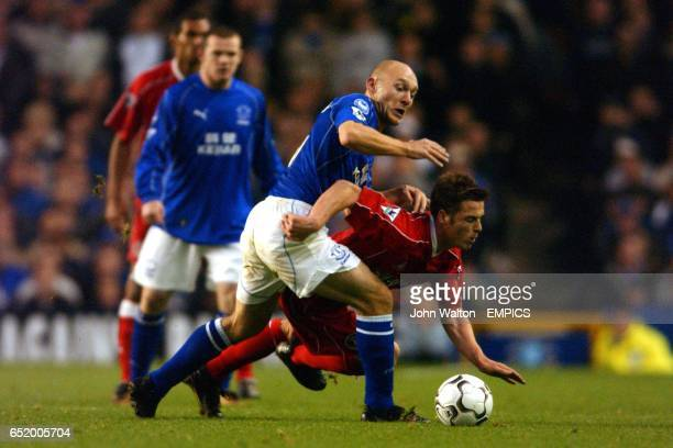 Charlton Athletic's Scott Parker battles for possession of the ball with Everton's Lee Carsley