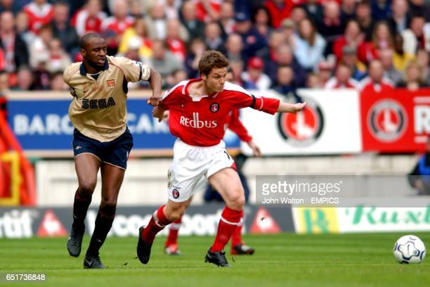 Charlton Athletic's Scott Parker is pulled back by Arsenal's Patrick Vieira