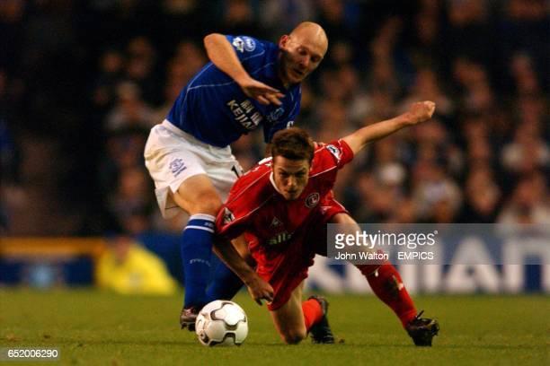 Charlton Athletic's Scott Parker stumbles under the challenge of Thomas Gravesen