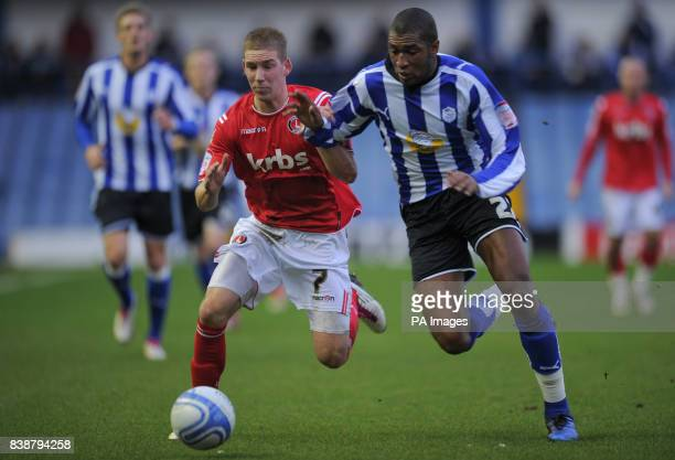 Charlton Athletic's Scott Wagstaff is challenged by Sheffield Wednesday Reda Johnson during the npower League One match at Hillsborough Sheffield