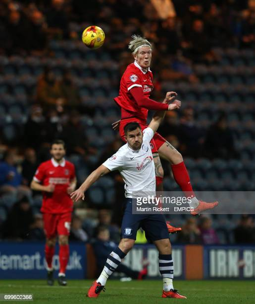 Charlton Athletic's Simon Makienok battles for the ball with Preston North End's Bailey Wright