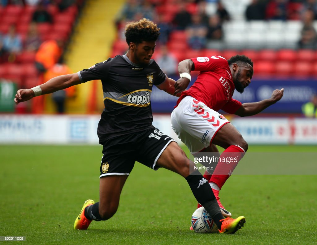 Charlton Athletic's Tarique Fosu holds of Josh Laurent of Bury during Sky Bet League One match between Charlton Athletic against Bury at The Valley Stadium London on 23 Sept 2017