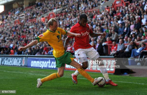 Charlton Athletic's Therry Racon and Norwich City's Stephen Hughes battle for the ball