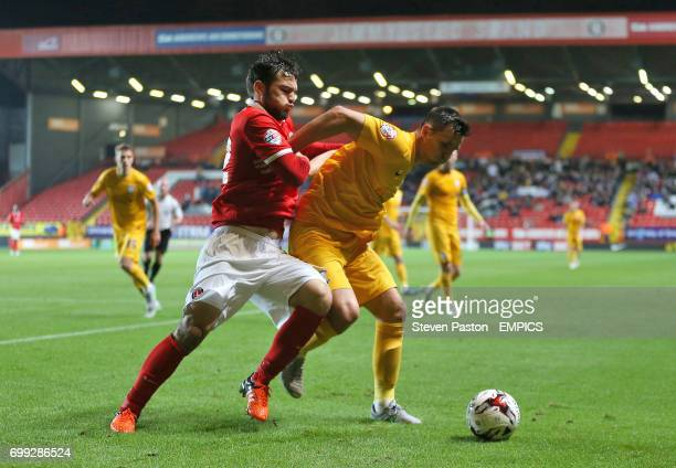 Charlton Athletic's Tony Watt and Preston North End's Bailey Wright in action