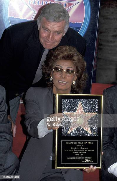 Charlton Heston and Sophia Loren during Sophia Loren Receives A Star on the Walk of Fame February 1 1994 at Hollywood Boulevard in Hollywood...