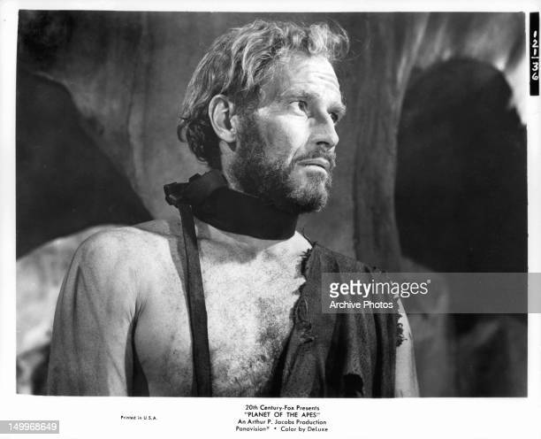 Charlton Heston dressed in rags provided by his captors in a scene from the film 'Planet Of The Apes' 1968