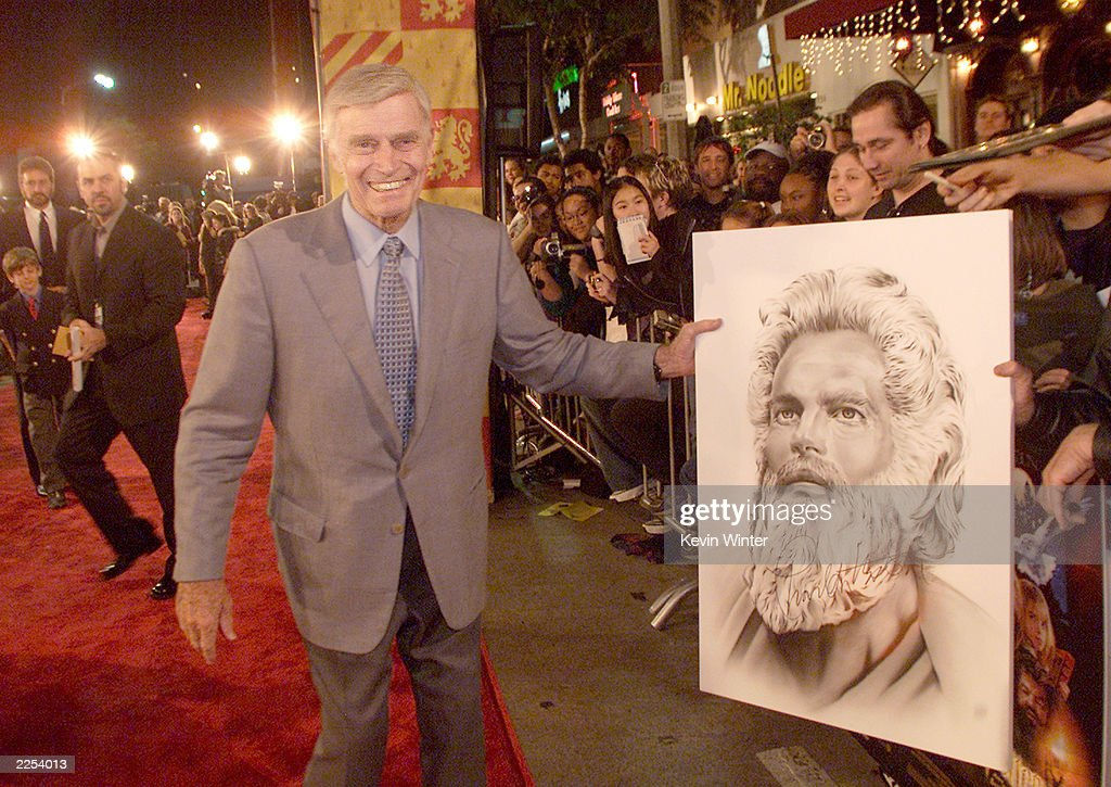 Charlton Heston signed autographs for fans at the premiere of 'Harry Potter and the Sorcerer's Stone' in Los Angeles, Ca. Wednesday, November 14, 2001. Photo by Kevin Winter/Getty Images.