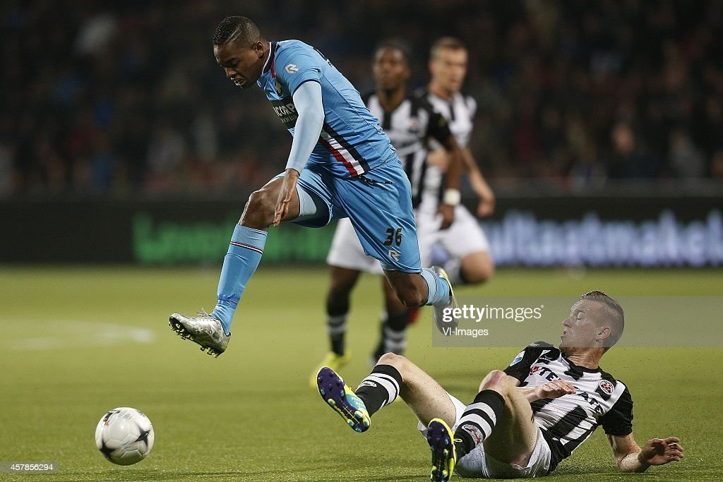 Charlton Vicento of Willem II Mike te Wierik of Heracles Almelo during the Dutch Eredivisie match between Heracles Almelo and Willem II at Polman...