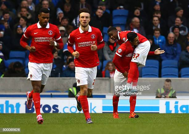 Charlton's Ademola Lookman celebrates with team Reza Ghoochannejhad after scoring the teams first goal during the Sky Bet Championship match between...