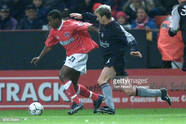 Charlton's Kevin Lisbie and Liverpool's Stephane Henchoz challenge for the ball during the Barclaycard Premiership Match at the Valley London THIS...