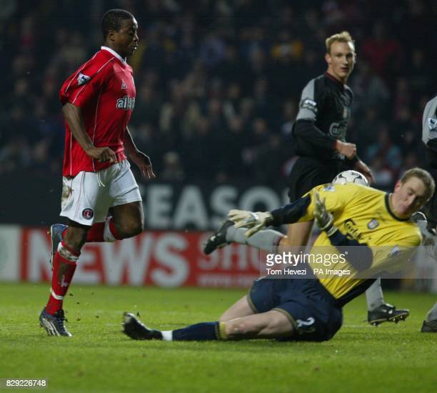 Charlton's Kevin Lisbie trys to chip Liverpool's goalkeeper Chris Kirkland during the Barclaycard Premiership Match at the Valley London THIS PICTURE...
