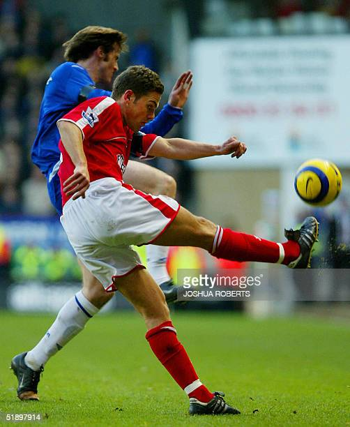 Charlton's Luke Young clears the ball past Everton's Kevin Kilbane at the Valley in London 28 December 2004 AFP PHOTO/JOSHUA ROBERTS NO TELCOS...
