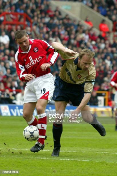 Charlton's Luke Young tries to stop Arsenal's Dennis Bergkamp during the FA Barclaycard Premiership match between Charlton and Arsenal at The Valley...