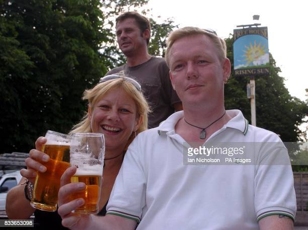 Charlwood villagers Grant and Lynda Marshall enjoy a drink at the local public house The Rising Sun as the alltime record British temperature for the...