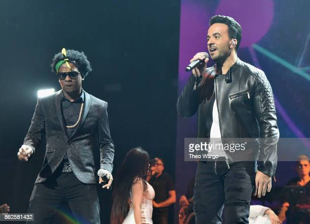 Charly Black and Luis Fonsi perform onstage during TIDAL X Brooklyn at Barclays Center of Brooklyn on October 17 2017 in New York City