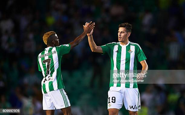 Charly Musonda and Alex Alegria of Real Betis Balompie celebrates after wining during the match between Real Betis Balompie vs Malaga CF as part of...