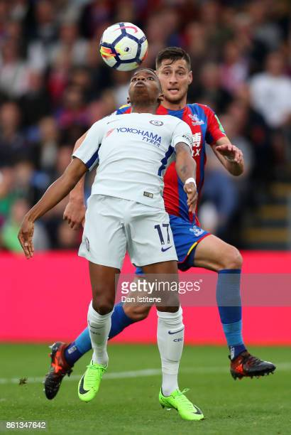 Charly Musonda of Chelsea controls the ball under pressure from Joel Ward of Crystal Palace during the Premier League match between Crystal Palace...