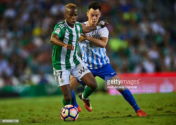 Charly Musonda of Real Betis Balompie competes for the ball with Juan Pablo Anor 'Juanpi' of Malaga CF during the match between Real Betis Balompie...