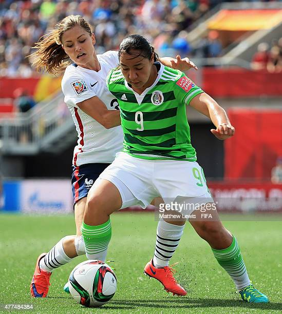 Charlyn Corral of Mexico holds off Laure Boulleau of France during the FIFA Women's World Cup 2015 Group F match between Mexico and France at...