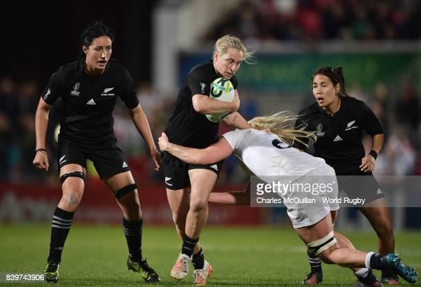 Charmaine McMenamin of England tackles Kelly Brazier of New Zealand during the Women's Rugby World Cup 2017 Final between England and New Zealand at...