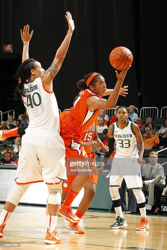 Charmaine Tay #1 of the Clemson Lady Tigers is called for to many steps as she goes past Shawnice Wilson #40of the Miami Hurricanes ton her way to the basket on January 3, 2013 at the BankUnited Center in Coral Gables, Florida. Miami defeated Clemson 78-56.