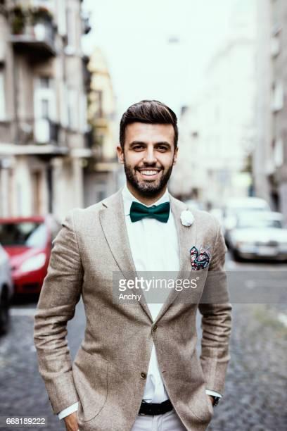 Charming arab hipster posing on paving stone