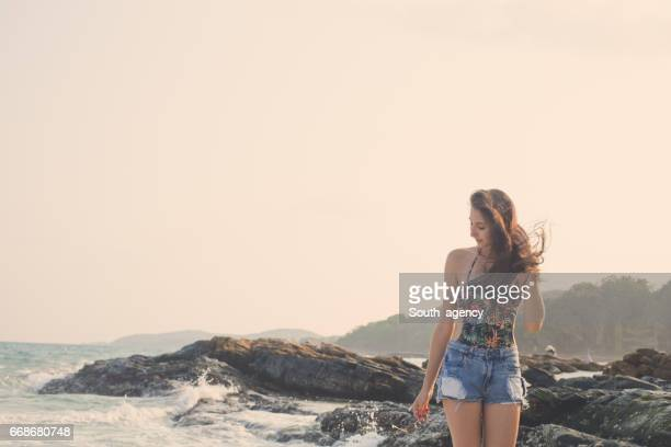 Charming brunette by the sea